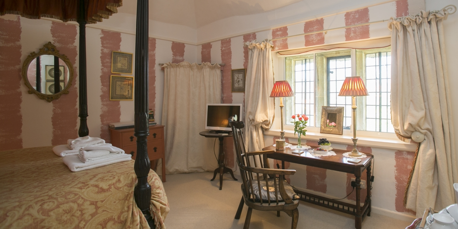 Four-poster bedroom at Tudor Cottage Guest House Dorchester